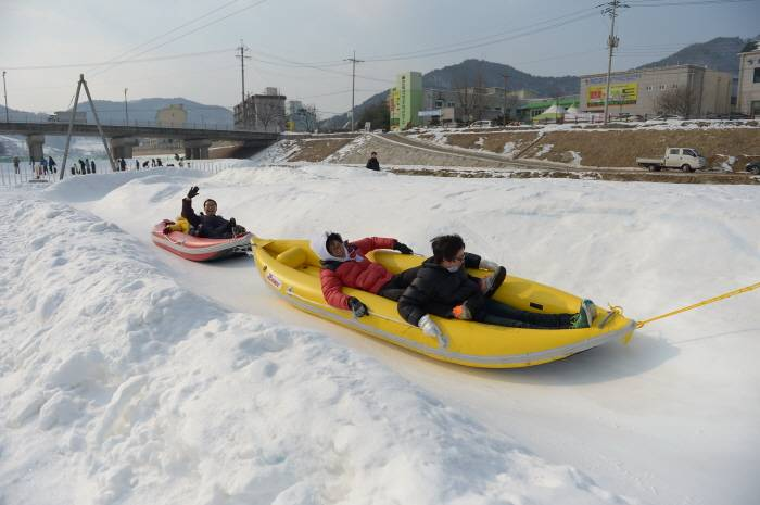 Hwacheon Sancheoneo Ice Festival Korea fishing trout winter travel festival activity performance snow sledding