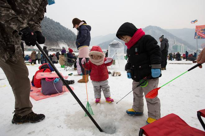 Hwacheon Sancheoneo Ice Festival Korea fishing trout winter travel festival activity performance